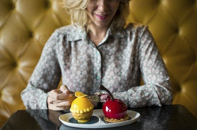 Woman with desserts at a cafe