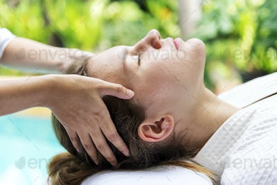 Caucasian woman relaxing with spa message