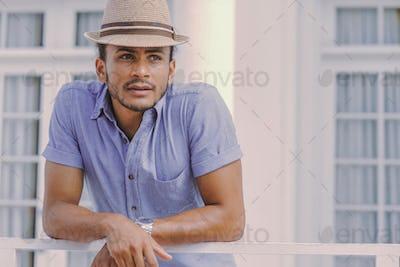 Handsome man at handrail