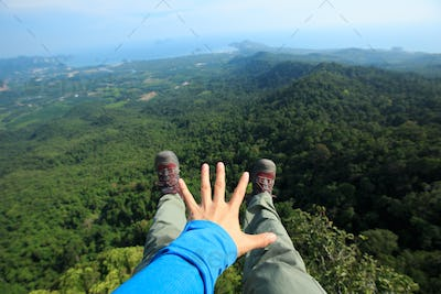 Hands reaching out the beautiful landscape