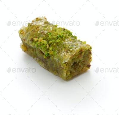 pistachio rolls baklava, fistikli sarma, turkish traditional dessert isolated on white background