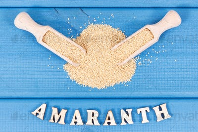 Heap of amaranth with wooden scoop as source vitamins, minerals and dietary fiber
