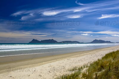 White Sand Beach With Blue Sky at Waipu in New Zealand