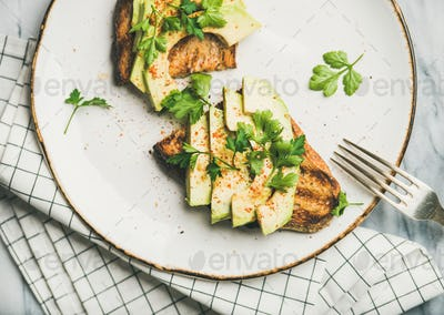 Flat-lay of avocado toast on plate, top view