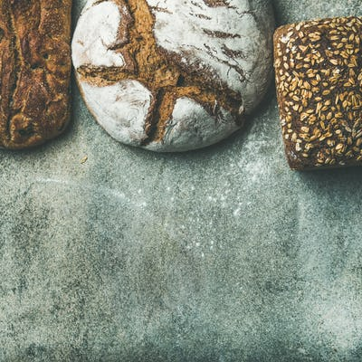 Top view of bread loaves over grey background, square crop