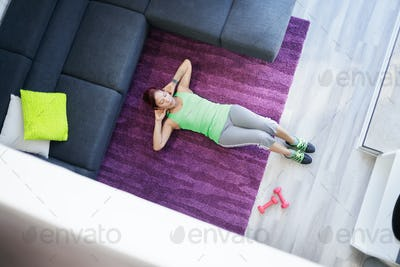 Old Woman Exercising And Doing Sport Activity At Home