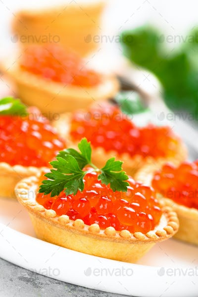Tartlets with red salmon fish caviar, salmon caviar. Caviar