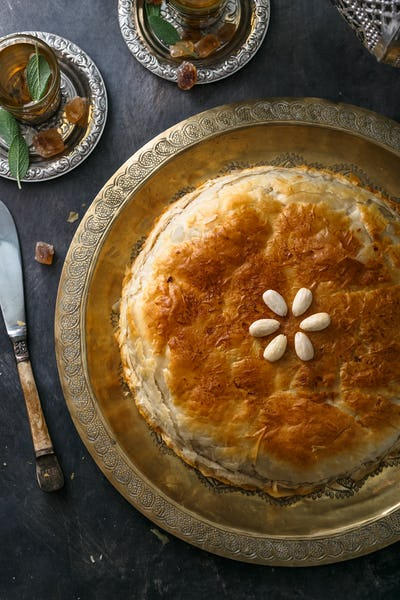 Top view of bastilla, layered moroccan pie with chicken