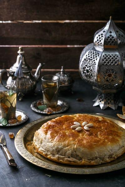 Moroccan chicken bastilla on copper plate, close view