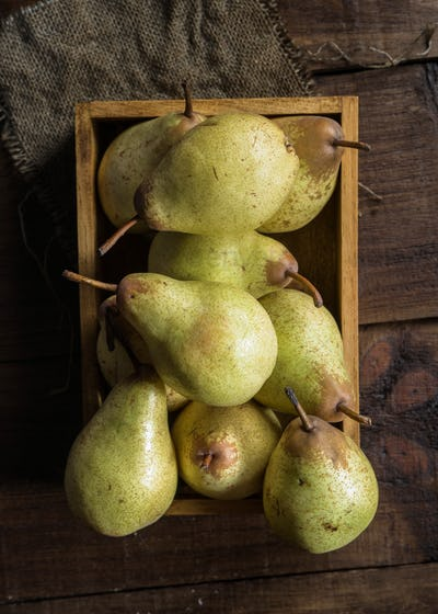 pears in box on canvas and wooden board