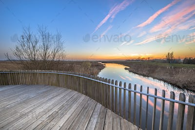 Planking balustrade sunset over swamp