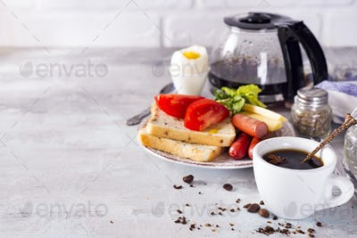 Fresh delicious breakfast with soft boiled egg, crispy toasts and cup coffee