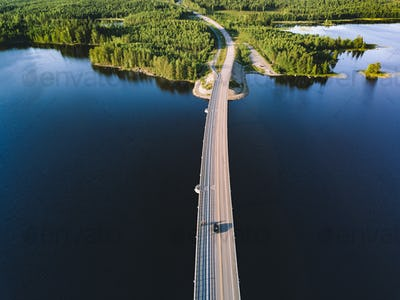 Aerial view of bridge across blue lake in summer landscape in  Finland