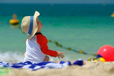 Two year old toddler boy beach