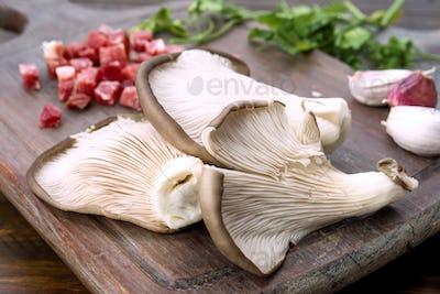 raw mushrooms on kitchen table