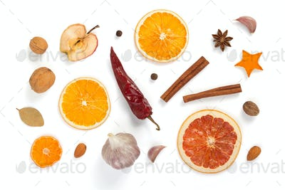dried fruit and spices on white background