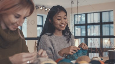 Knitting girls in studio