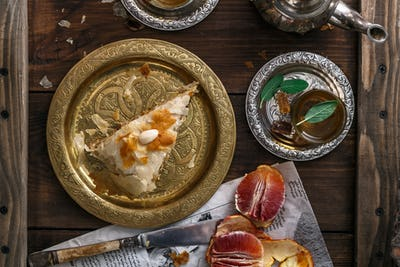 Traditional moroccan copper plate with piece of pie