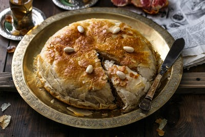 Crusty pie with chicken, close view, arabian style