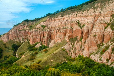 Succession of red and white clays with dinosaur fossils. Geological reserve of Rapa Rosia, Romania