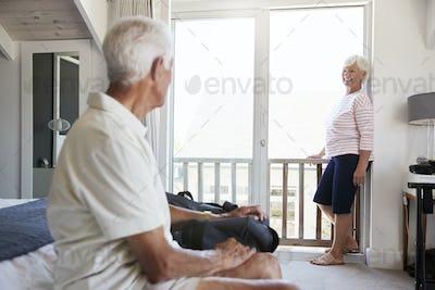 Senior Couple Arriving At Summer Vacation Rental