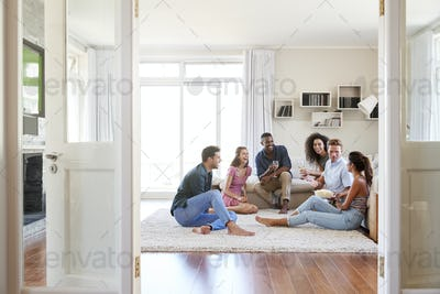 Group Of Friends Relaxing At Home And Drinking Wine Together