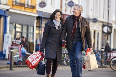 Mature Couple Enjoying Shopping In City Together