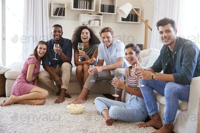 Portrait Of Friends Relaxing At Home And Drinking Wine Together