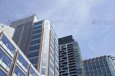 LONDON - MAY, 2017: Low angle view of modern glass fronted buildings