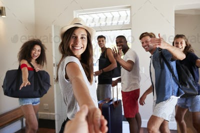 Point Of View Shot Of Friends Leaving Summer Vacation Rental