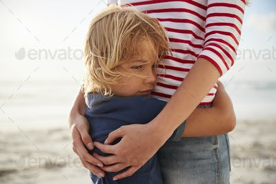 Close Up Of Mother Hugging Son On Summer Beach Vacation