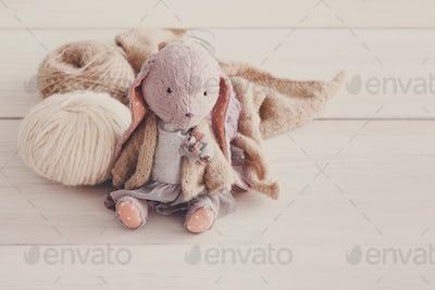 Cute handmade rabbit with wool close up