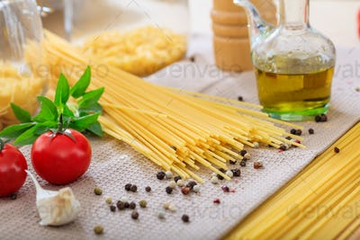 Raw spagetti pasta with vegetables