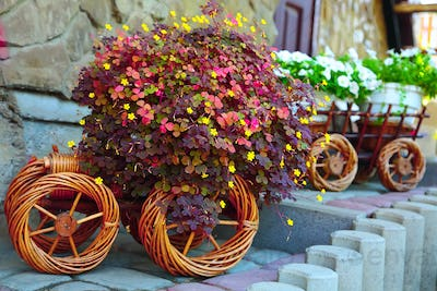 Artificial flowers in a cart