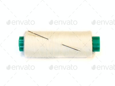 needle and a spool of thread