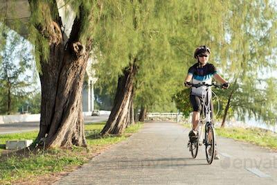 Senior Asian woman riding a bicycle
