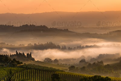 Tuscan Village Landscape on a Foggy Morning
