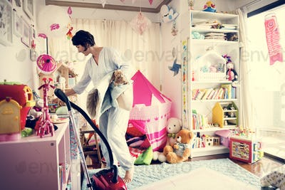 Mother cleaning daughter's room