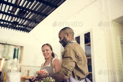 Couple cooking in a kitchen together