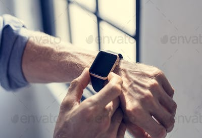 Businessman checking his smart watch