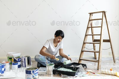 Woman renovating the house