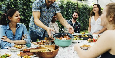 Group of diverse friends enjoying summer party together