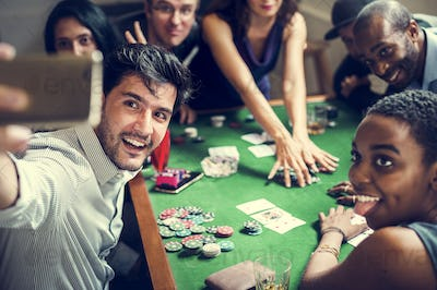 Group of people playing gambling together