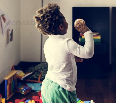 Black kid throwing baseball ball
