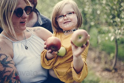 Little girl holding some apples