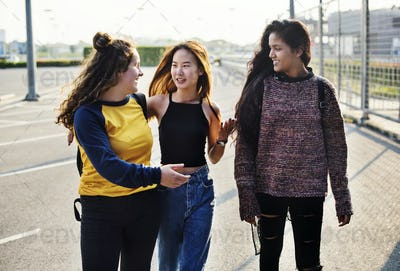 Teenage girl friends walking together