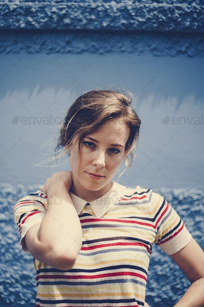 Portrait of caucasian beautiful woman with blue background