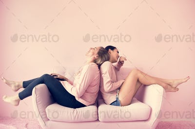 Women friends sitting in living room together
