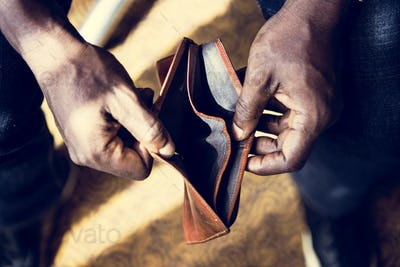 Man checking his empty wallet