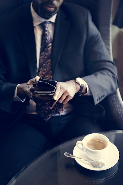 Businessman in cafe for a hot drink